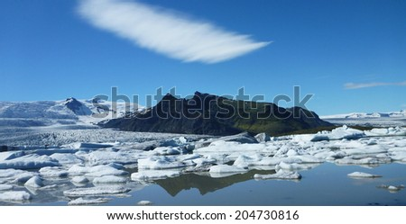 Melting glacier ice at Jokulsarlon lake caused by global warming - stock photo