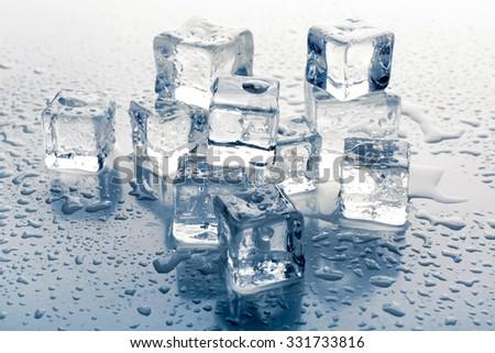 Melting ice cubes on grey background, close up - stock photo