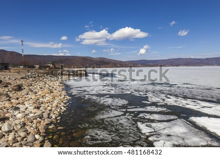 Melting ice on the Baikal lake in spring