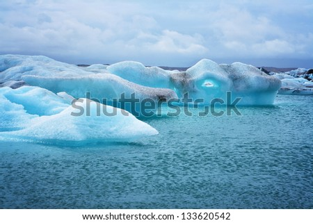 Melting iceberg at lagoon in Iceland - stock photo