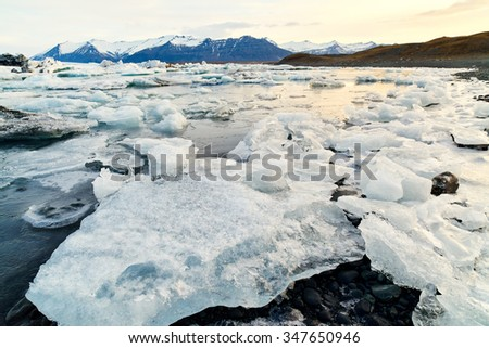 Melting icebergs in jokulsarlon glacier Lagoon, beautiful icy landscape in southeast iceland, a famous natural tourist attraction - stock photo