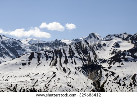 Melting snow in high elevation mountains of British Columbia in spring. - stock photo
