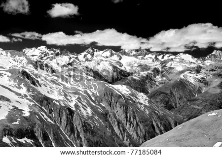 melting snow in the mountains in the spring time in black and white