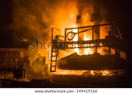 melting waste iron use electric old method in a steel making factory