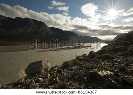 Meltwater rivers flowing through arctic tundra, Greenland - stock photo