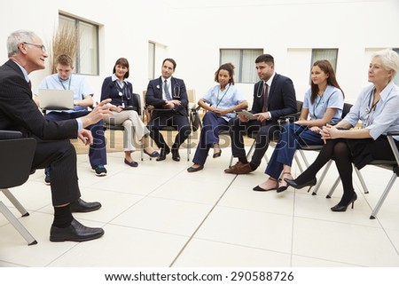 Members Of Medical Staff In Meeting Together - stock photo