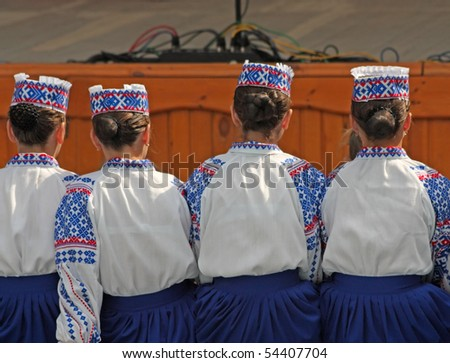 Members of the folk group waiting for  performance - stock photo