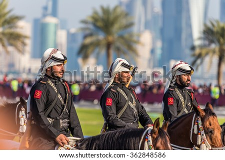 Members of the Qatari Police during Qatar National Day celebrations in Doha on 18th of December 2015. - stock photo