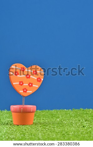 memo holder on the grass field - stock photo