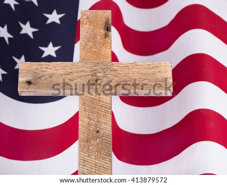Memorial Day wooden cross over an American flag - stock photo