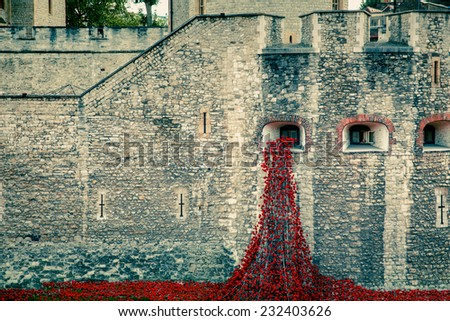 Memorial red poppies at Tower of London - stock photo