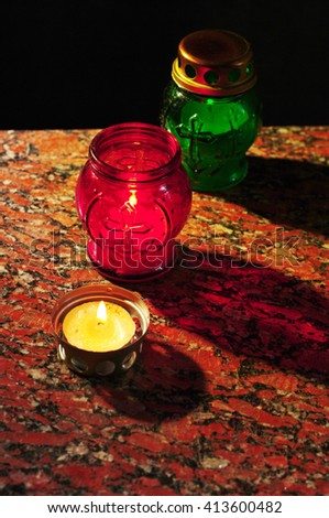 Memory candles on the tombstone - stock photo