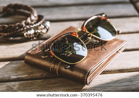 men accessories, closeup brown sunglasses