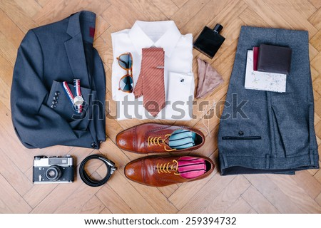 Men accessories on vintage wooden table - stock photo