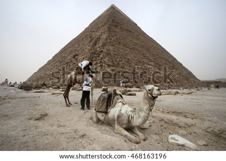Men and Camel  at Great Pyramid of Egypt