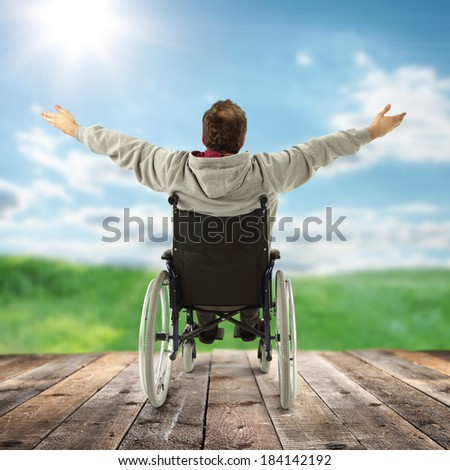 men and wheelchair and blue sky