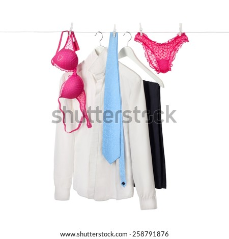 Men and women clothes hanging on the rope, isolated on white - stock photo