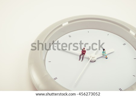 Men and women sitting on watch