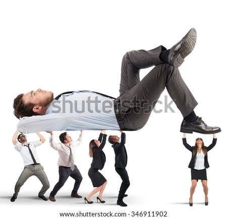 Men and women support a big man - stock photo