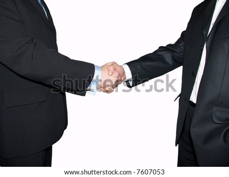 Men are shaking hands on a grey background.