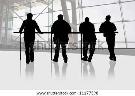 Men are waiting in a station - stock photo