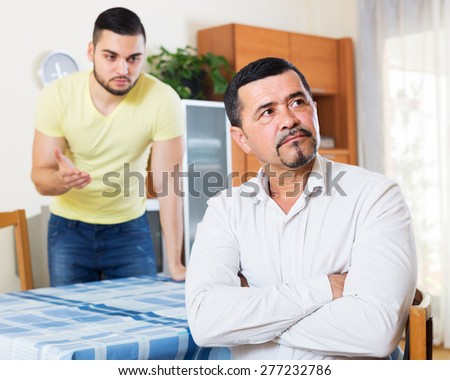 Men arguing about something indoors - stock photo