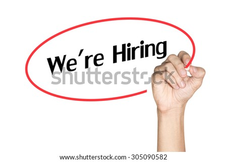 Men arm writing We are Hiring with highlighter pen on white background - stock photo