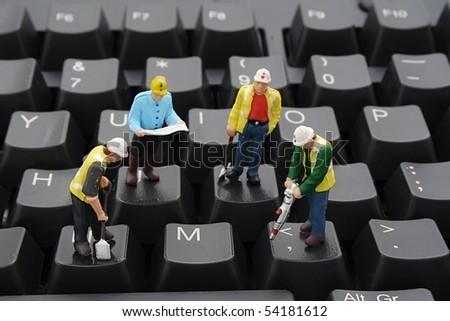 Men At Work on Computer Keyboard - stock photo