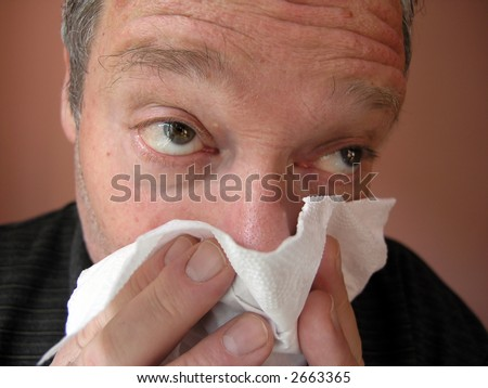 Men blowing his nose. - stock photo