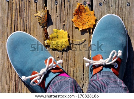 Men blue casual shoes on wooden path - stock photo