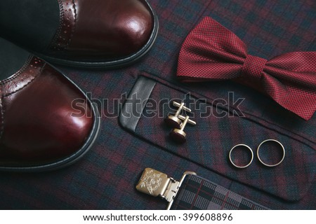 Men burgundy suit, bow tie and vintage leather shoes - stock photo