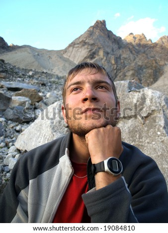 Men climber thinks about mountains.