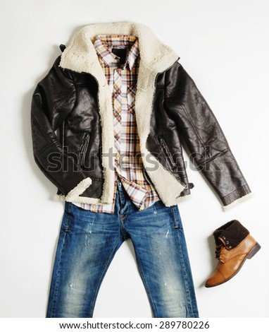 men clothes in a shape of man that he wearing then and with a shoe in the right isolated with shadows - stock photo