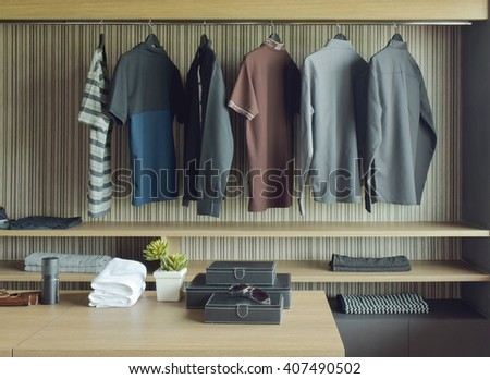 Men cloths in wooden walk in closet - stock photo