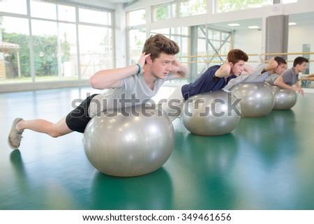 men doing exercise - stock photo