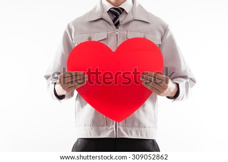 Men dressed in work clothes, red heart