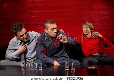 Men drinking shots in night club - stock photo