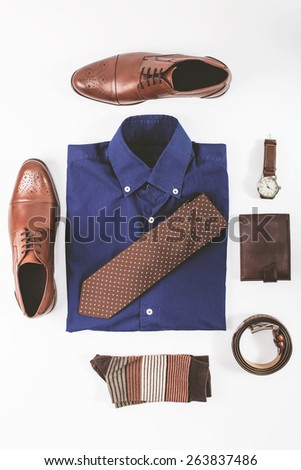 Men fashion. Men accessories. Men shoes, shirt, tie, socks,wallet, belt and watch. Still life. Business look. - stock photo