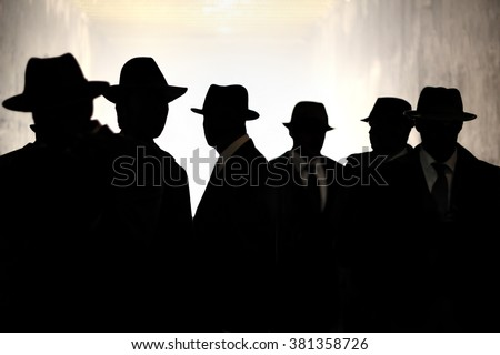 Men Fedora Hats silhouette. Security, Privacy, Surveillance Concept. - stock photo