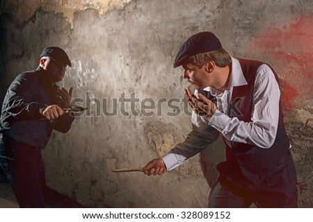 Men fighting with knives at urban street