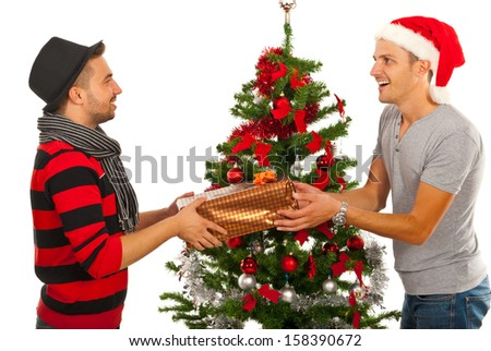 Men friends giving Christmas present to each other isolated on white background - stock photo