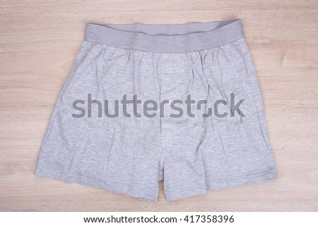 Men gray boxer shorts on wooden background