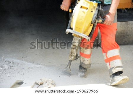 Men hard working on concrete drilling - stock photo