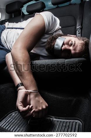 men hostage backseat  - stock photo