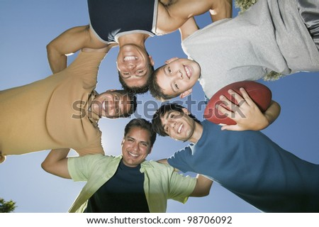 Men in a Football Huddle - stock photo