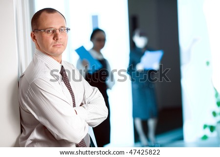 Men in glasses with tie and with folder - stock photo