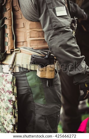 men in military uniform with weapon on a mission - stock photo