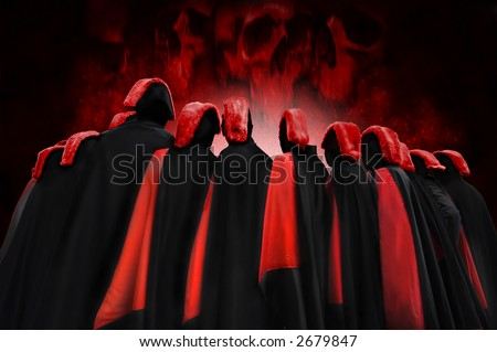 Men in red and black robes facing a skull-shaped flame - stock photo