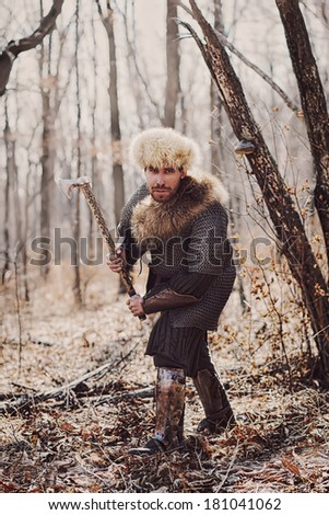 Men in russian panoply fighting in forest - stock photo