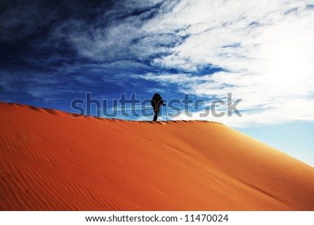 Men in sand desert